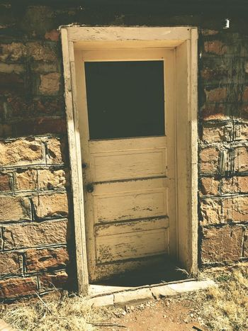 """""""Where Do I Go?"""" A mysterious door in an old stone wall in the Village of Corona, New Mexico begs for exploration. New Mexico Photography New Mexico Stone Wall Stone Weathered Doorway Doors Architecture Built Structure Entrance Building Exterior No People Door Building Sunlight Old Abandoned"""