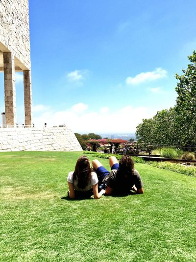 Grass Sky Togetherness Architecture Built Structure Day Sitting Building Exterior Real People Men Leisure Activity Women Tree Lifestyles Outdoors Nature Friendship Adult People Getty Museum Los Angeles, California
