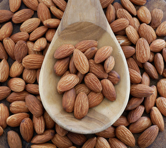 Almonds in wooden spoon on almonds background. Seed Toast Almond Brown Dieting Dry Fiber Food Healthy Eating Ingredient Nut Nut - Food Nutrition Organic Food Protein Raw Food Snack Vegan Food Vegetarian Food Wellbeing Wooden Spoon