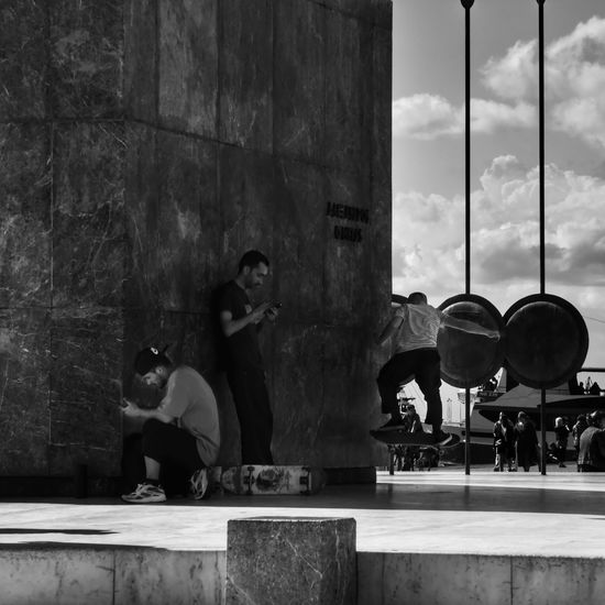 Youth Culture... Eye4photography  EyeEm Gallery Real People Youth Of Today Youth Culture Blackandwhite EyeEm Best Shots Skateboarding Mobile Phone Streetphotography b&w street photography B&w Sunlight And Shadow City Life City Street Young Men Hanging Out Contemporary Today :) Daily Life See What I See Men Sitting Architecture Built Structure Historic Street Performer
