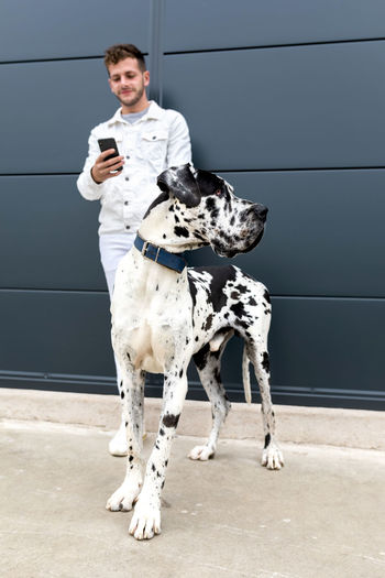 Full length of man standing with dog