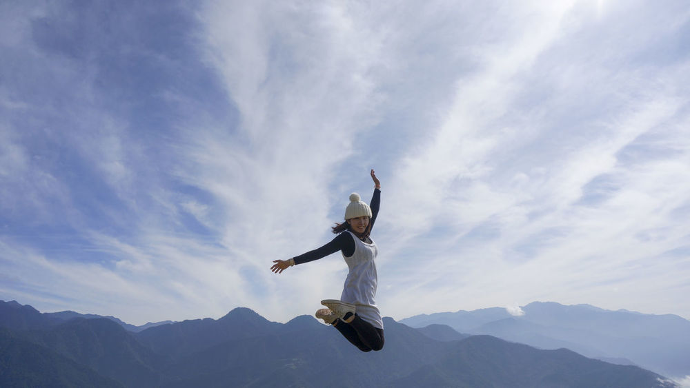 Woman Coulds And Sky Adventure Jumping Jump Jumpshot Jumpstagram Jump! Blue Sky Mountains Mountain View Positive Positivity Energy Fullofenergytoday