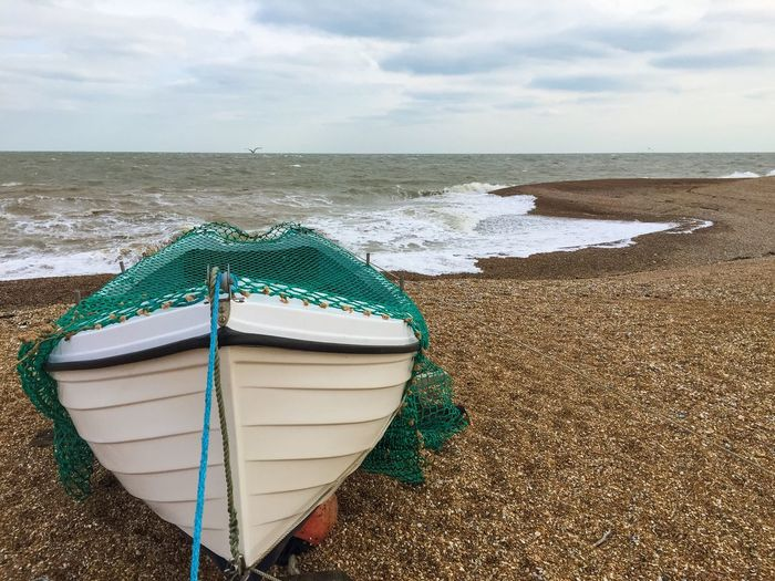 Fishing Boat Moored Beach Shingle Pebbles Fishing Net Green Crashing Sea Sea Scape Bird Hovering Wild Wilderness Rugged Coastline Dungeness