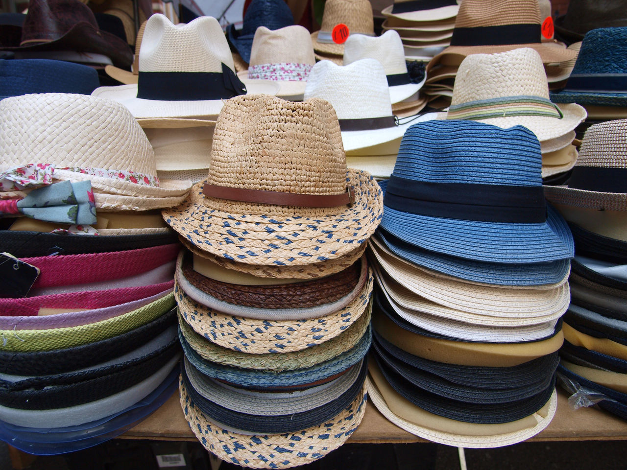 for sale, retail, large group of objects, market, choice, arrangement, hat, variation, still life, market stall, stack, collection, multi colored, clothing, no people, store, shopping, small business, abundance, retail display, sale, order, consumerism