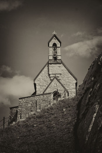 Church at Wendelstein, Bavarian Alps Alpen Black & White Church Panorama Wendelstein Alps Architecture Bavarian Alps Bell Tower Black And White Blackandwhite Building Exterior Built Structure Cloud - Sky Cross History Low Angle View No People Outdoors Place Of Worship Religion Sepia Sky Spirituality Travel Destinations
