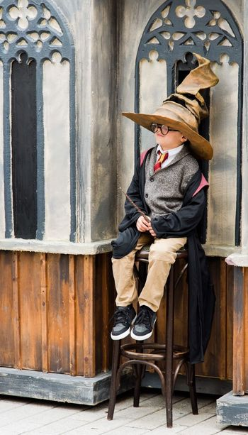 Young boy getting sorted at a wizard Ing world of Harry Potter festival. EyeEm Selects Eye4photography  Eyem Gallery Eyemphotography Fun Games Pretend Play Make Believe MOVIE Fantasy Photography Imagination Children Sorting Hat Wizard World Harry Potter Outdoors Photograpghy  Sitting One Person Full Length Front View People Day One Man Only Portrait Child