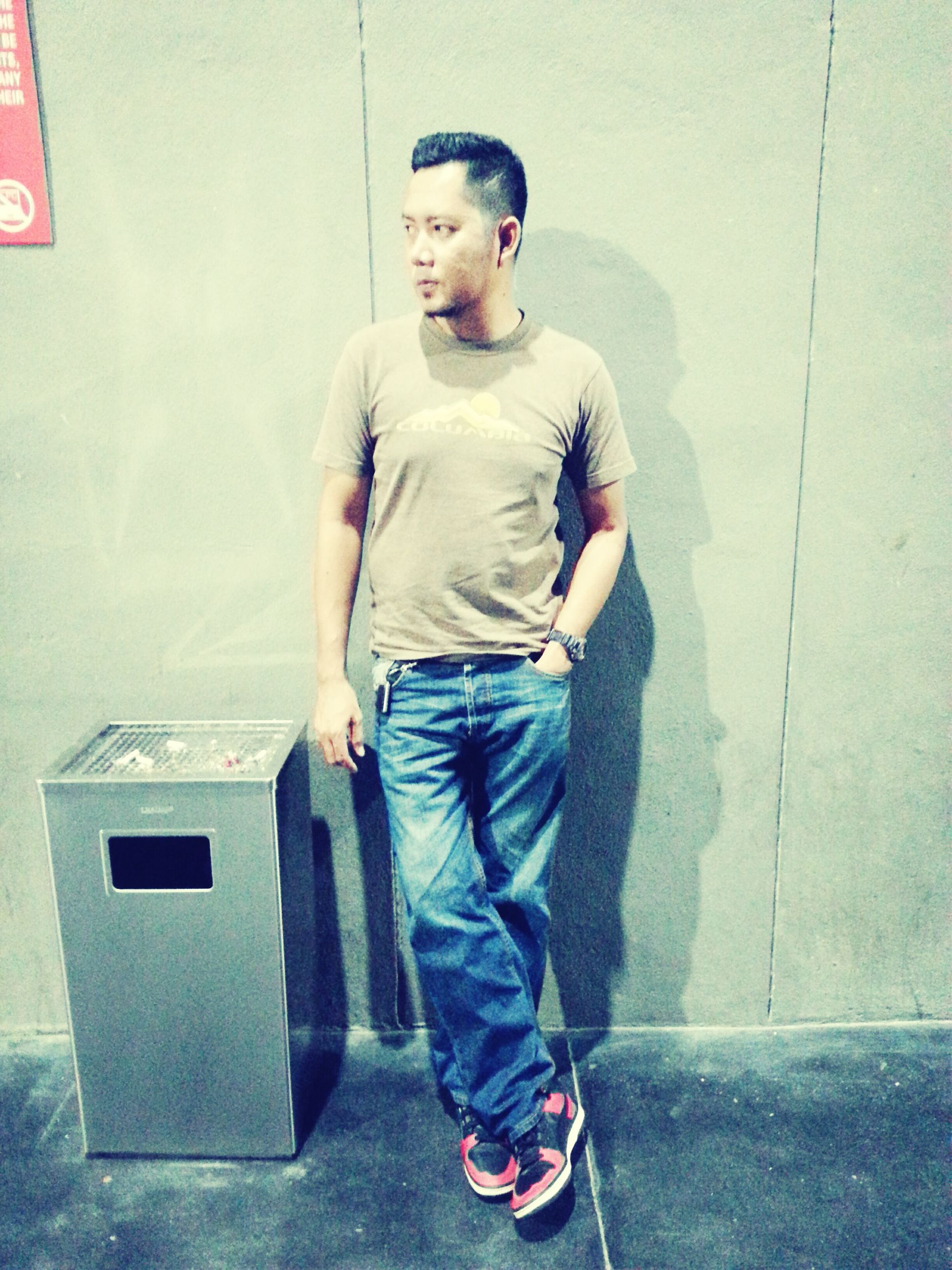 casual clothing, full length, lifestyles, standing, person, wall - building feature, front view, built structure, architecture, holding, leisure activity, indoors, portrait, looking at camera, three quarter length, young adult, young men, wall