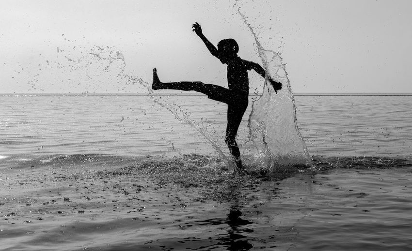 Splish-Splash Art Blacmagic Day Enjoyment Formby Formbybeach Freedom Fun Jumping Leisure Activity Lifestyles Liverpool Nature Outdoors Sea Sky Slihouette Splashing Vacations Water
