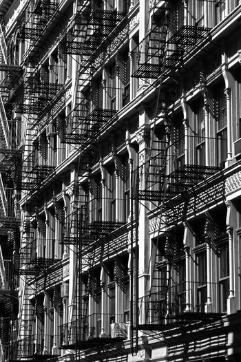 EyeEmNewHere Bw Outside LINE Architecture Fire Escape City Urgency Full Frame Steps And Staircases Window Cast Iron Staircase Safety Residential Building Stairs Hand Rail Stairway 17.62° My Best Photo