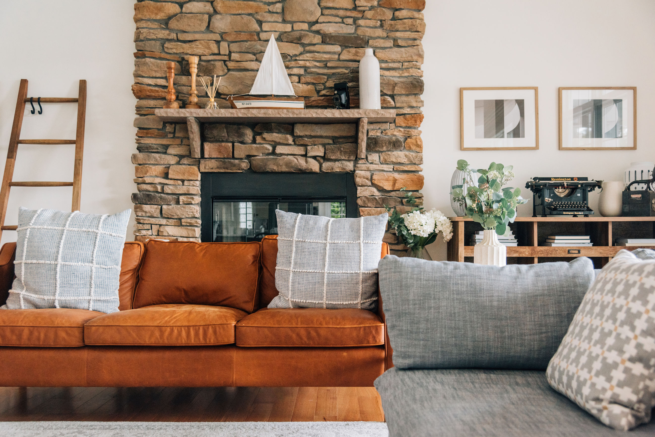 furniture, sofa, pillow, living room, home interior, stuffed, no people, cushion, domestic room, indoors, table, built structure, home, architecture, day, wood - material, absence, comfortable, building, wall - building feature