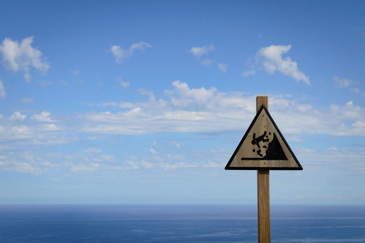 Blue Blue Sky Clouds Sign Signs Warning Warning Sign Falling Fall Down Summer Summertime Summer Views Coast Vista Ocean Ocean View Sea Sea And Sky Seaside Water Holiday Day Outdoors First Eyeem Photo Holiday POV