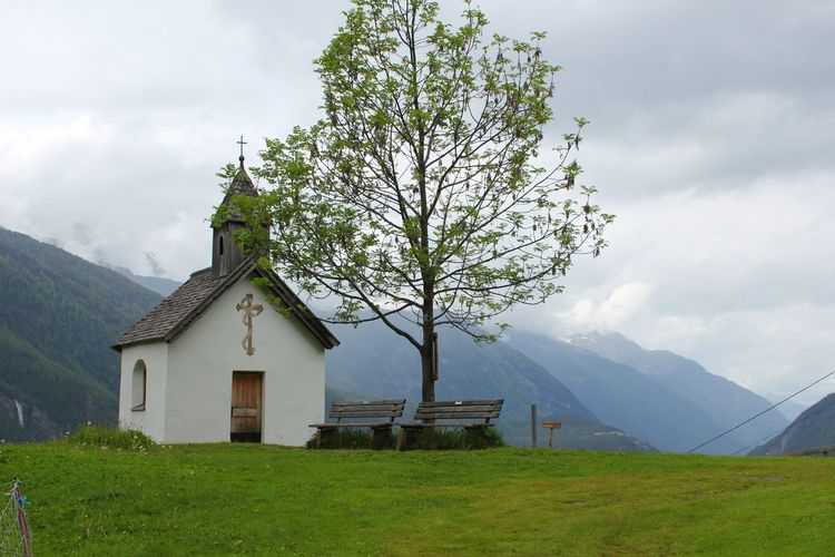 Architecture Beauty In Nature Built Structure Chapel Cloud Cloud - Sky Cloudy Day Field Grass Grassy Green Color Growth Landscape Mountain Mountain Chapel Mountain Range Nature Outdoors Rural Scene Scenics Sky Tranquil Scene Tranquility Tree