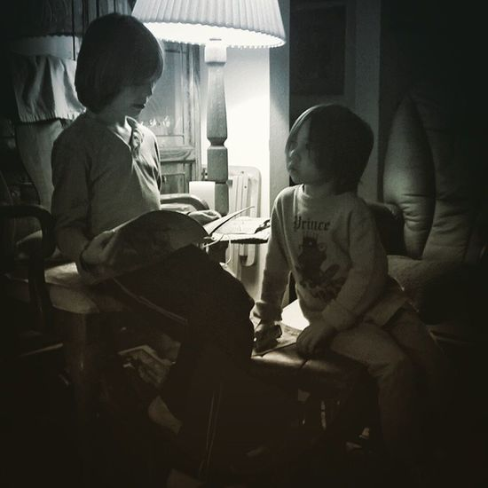 """A portrait of two friends enjoying reading about trains. A peaceful, precious and beautiful thing to observe!"""":) children's portrait Friends Reading Listening Quiet Moments Quiet Play Concentrating Story Time Emotion Looking Up Lookingdown #looking cute #looking at photos!"""