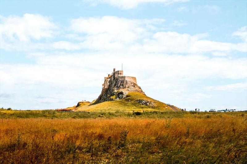 Beautiful castle on a hill in lindisfarne uk.