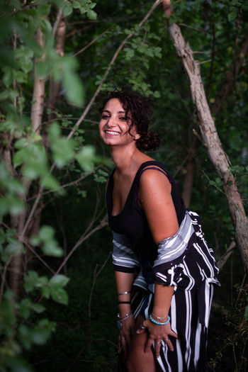 Happy young woman in forest