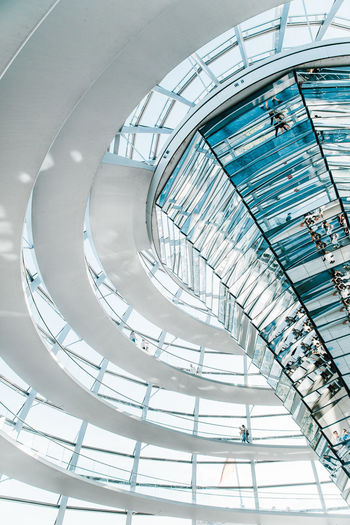 Architecture Built Structure Glass - Material Indoors  Low Angle View Modern Ceiling Railing Architectural Feature Day Staircase Steps And Staircases No People Spiral Pattern Shopping Mall Skylight Transparent Design Directly Below Steel Alloy