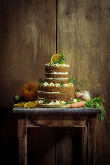 Cake On Wooden Table Against Wall