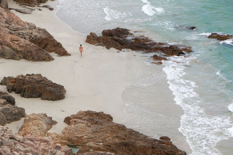 High angle view of woman standing on beach