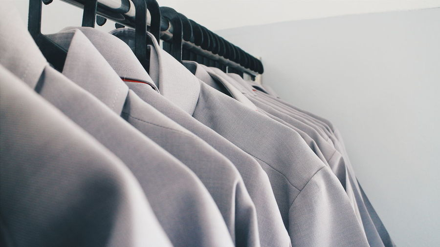 Close-Up Of Full Suits Arranged In Closet