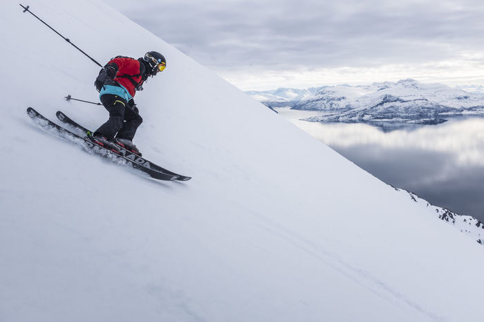 From summit to sea Adventure Beauty In Nature Cloud - Sky Cold Temperature Covering Day Landscape Leisure Activity Lifestyles Mountain Nature Season  Sky Snow Snowcapped Mountain Sport Tranquil Scene Tranquility Unrecognizable Person Vacations Warm Clothing Weather White Color Winter Winter Sport