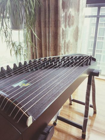 The sunny morning. Relaxing My mom is reading books and I am playing the guzheng. Enjoying Life