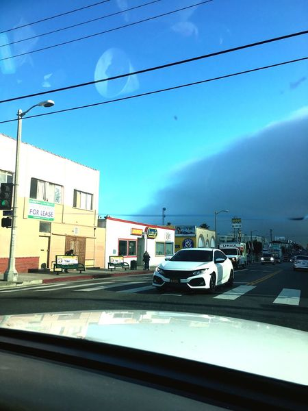 The Fog Fog Cars person 1stStreet San Pedro Mode Of Transportation Transportation Car Sky Motor Vehicle Architecture Cloud - Sky Building Exterior Built Structure Nature City Land Vehicle Street No People Day Road Outdoors Vehicle Interior