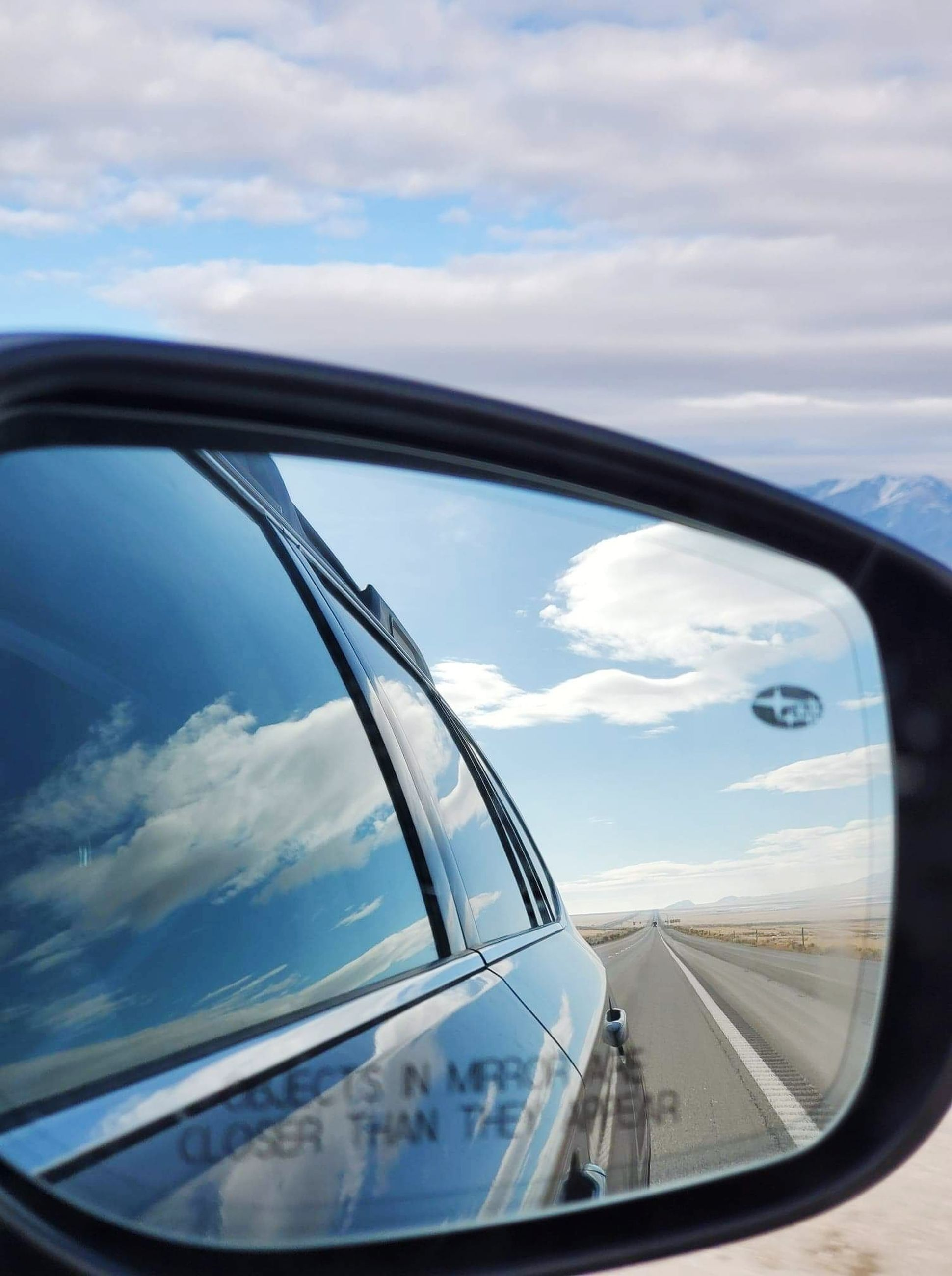 mode of transportation, motor vehicle, transportation, cloud - sky, sky, car, land vehicle, side-view mirror, reflection, no people, glass - material, nature, day, close-up, mirror, window, road, motion, vehicle mirror, outdoors, road trip