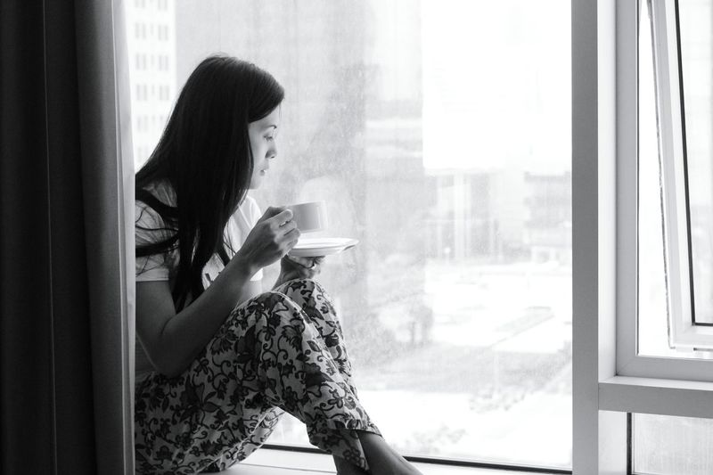 Window One Woman Only Looking Through Window Only Women Coffee - Drink Indoors  Coffee Cup One Person Adults Only Women Young Adult Home Interior Window Sill Black And White Eyeem Philippines Black & White Emotions In A Picture