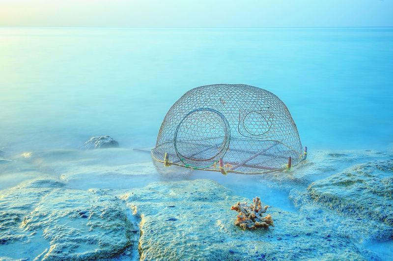 Hand crafted fish net , i shot this one during my way to Khasab. Coral EyeEm Best Shots Rock - Object Blue Sky Blue Fishing Fishing Net Shore Beach Sky Water Day No People Fishing Net Beauty In Nature Nature Outdoors