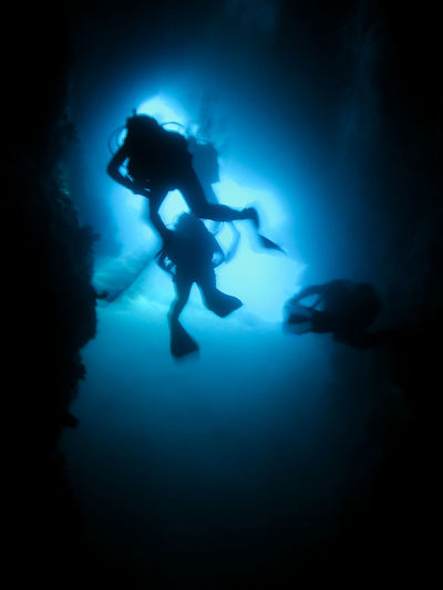 Silhouette of scuba divers in an underwater cave. Cave diving Adriatic Blue Cave Cave Diving Cavediving Cavern Croatia Danger Divers Exit SCUBA Scuba Divers... Scuba Diving Silhouette Underwater Underwater Photography