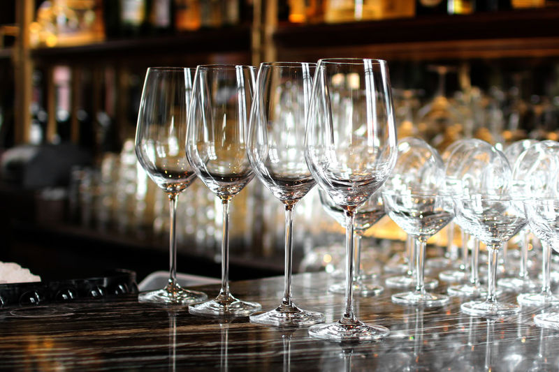 Champagne Flutes Arranged At Bar Counter
