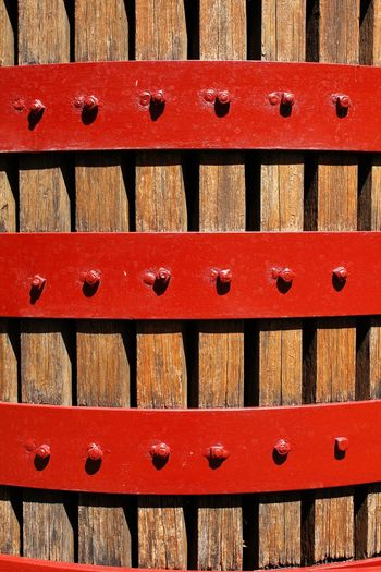 The structure of the wine press, an historical method of pressing grapes for wine making Abstract Architecture Arrangement Backgrounds Close-up Container Day Full Frame Historical In A Row Indoors  No People Pattern Red Stack Storage Compartment Textured  Traditional Winepress Wood - Material