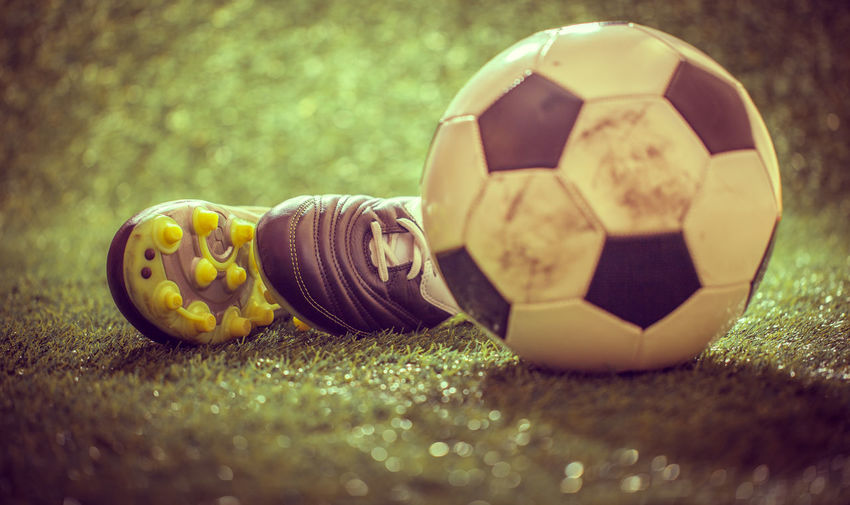 Close-up of soccer ball on land