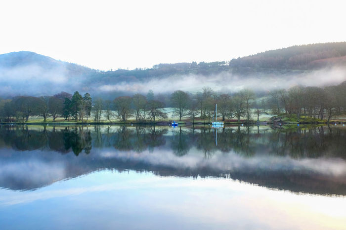 Lake District Lake District National Park Reflection Beauty In Nature Day Flat Calm Fog Lake Lake Windermere Misty Landscape Misty Morning Nature No People Outdoors Reflection Reflections In The Water Scenics Sky Tourist Destination Tranquil Scene Tranquility Tree Uk England Water Waterfront