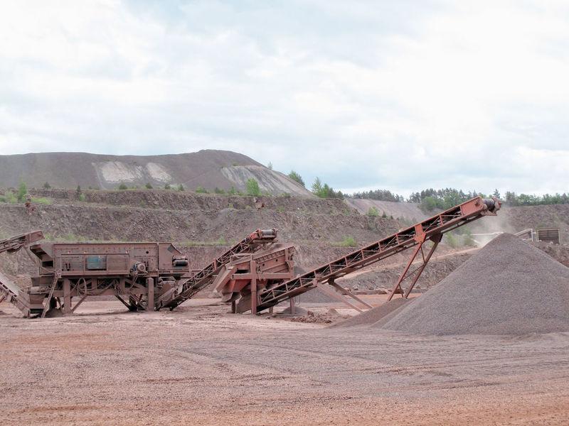 stone crusher machine in a quarry. open mine pit. mining industry Industry Open Pit Mine Machinery Steinbruch Stone Crusher Quarry Mining Mining Industry Steinbrecher Mine Conveyor Belt
