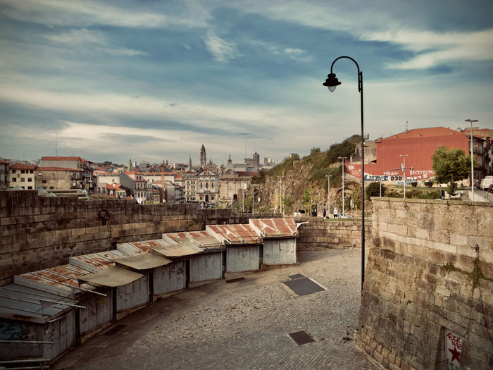 City Cityscape Oporto, Portugal Portugal Architecture Building Building Exterior Built Structure City Cityscape Cloud - Sky Color Community Day High Angle View Nature No People Outdoors Residential District Roof Sky Street Street Light Town TOWNSCAPE Wall