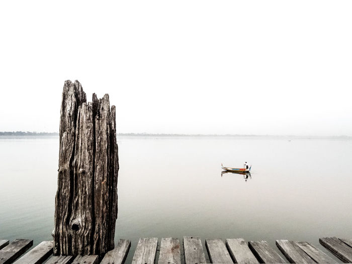 Beauty In Nature Boardwalk Boat Calm Idyllic Nature No People Pier Scenics Sea Sky The Great Outdoors - 2016 EyeEm Awards Tranquil Scene Tranquility Wood Wood - Material Wooden Nature's Diversities Ubeinbridge Ubein