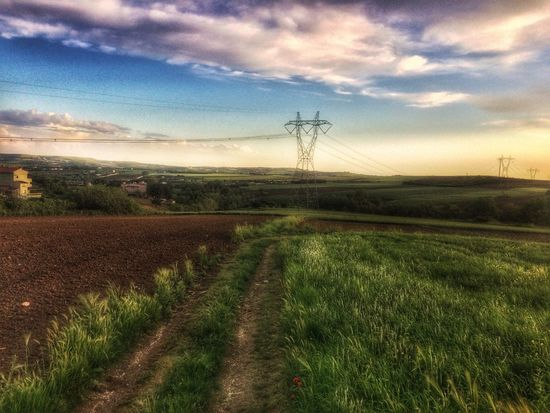 Field Sky Landscape Cloud - Sky Rural Scene Tranquility No People Tranquil Scene Nature Fuel And Power Generation Agriculture Scenics Beauty In Nature Electricity Pylon Outdoors Day Electricity  Grass Growth Technology