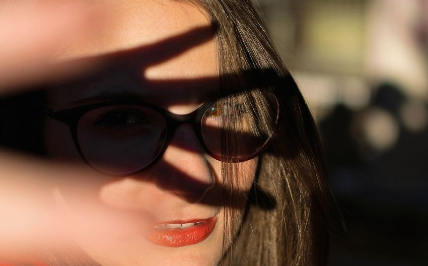 Close-up portrait of woman in eyeglasses