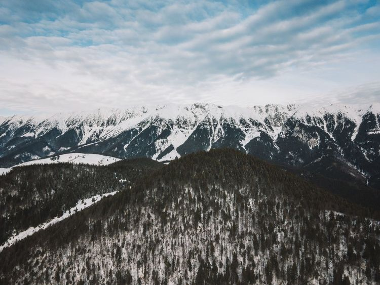 Drone  Above Aerial View Beauty In Nature Blue Sky Cloud - Sky Cold Temperature Day Frozen Landscape Mountain Mountain Range Mountains Nature No People Outdoors Scenics Sky Snow Snowcapped Mountain Tranquil Scene Tranquility Weather Wilderness Area Winter