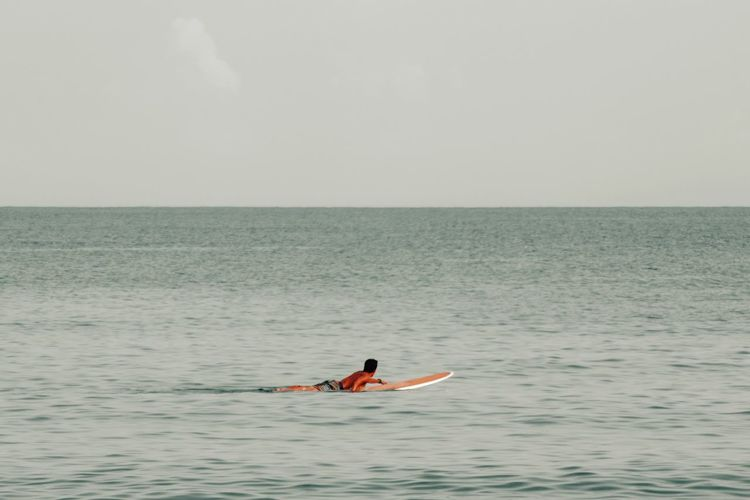 Waiting for big waves Beach Water Swim Swimming Sport Calm Waves Paddleboarding Oar Sea Athlete Full Length Water Exercising Sport Adventure Healthy Lifestyle Surfing Aquatic Sport Wave Surfer Water Sport