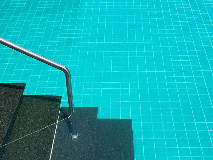 High angle view of staircase in swimming pool