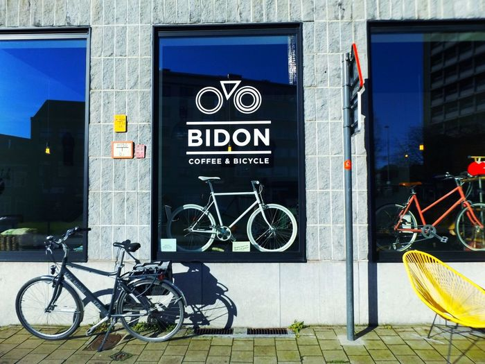 If you hesitate between a Coffee & a Bicycle, you will find both here No More Dilemma Streetphotography Coffee And Bicycle Windows City Trip Mirrors Enjoying Life Check This Out Funny EyeEm Gallery Bidon Coffee And Bicycle à Gand Ghent Gent