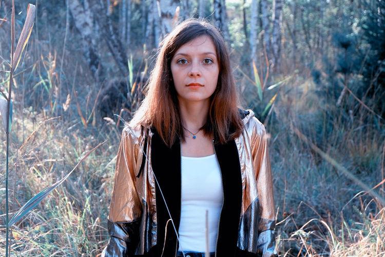 Portrait of woman against trees
