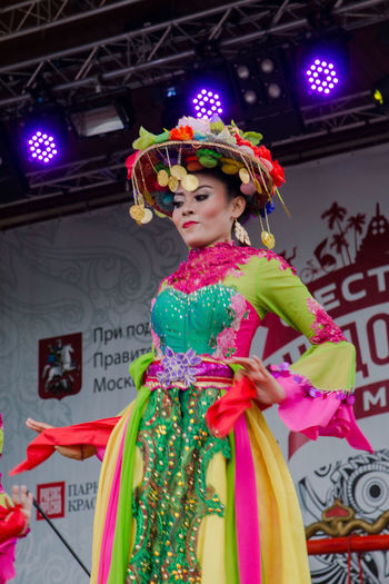 National dance of Indonesia Beautiful Woman Celebration Clothing Costume Festival Focus On Foreground Front View Hairstyle Indoors  Leisure Activity Lifestyles Multi Colored One Person Real People Smiling Standing Traditional Clothing Women Young Adult Young Women