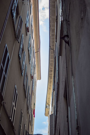 Milan,Italy Alley Apartment Architecture Building Building Exterior Built Structure City Clothesline Clothing Day Drying Hanging Laundry Low Angle View Narrow Nature No People Outdoors Residential District Sky Textile Window Summer In The City