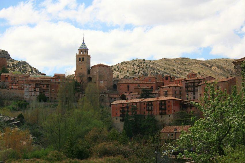 Medieval Spanish town Albarracín surrounded by mountains. Albarracín Church Church Tower Architecture Building Exterior Built Structure Church Architecture City Cloud - Sky Heritage Heritage Site History Mountain Town Old The Past Tower Town TOWNSCAPE Travel