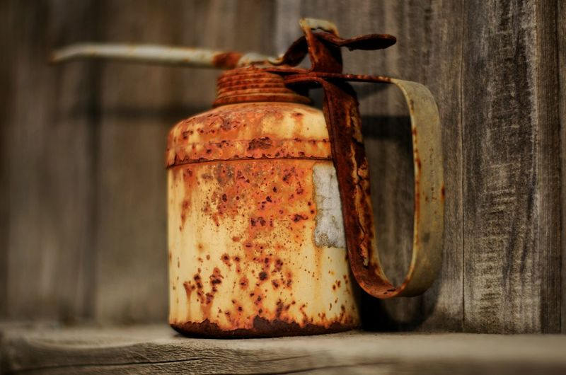 Rusty old Oilcan Rusty Metal Container Retro Steel Retro Wood Old Oil Can Jar Close-up Weathered Peeling Off Rusty