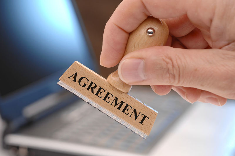 agreement printed on rubber stamp in hand Accepted Authority Business Government Office Acceptance Affirmation Agree Agreement Approval Approved Certificate Certification Close-up Communication Compliance Concept Conform Conformity Consent Contract Document Human Hand Stamp Text