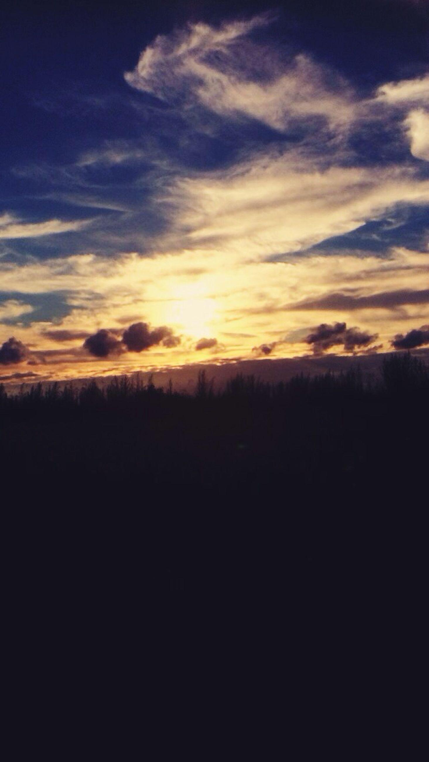 sunset, tranquil scene, silhouette, scenics, tranquility, beauty in nature, sky, landscape, nature, idyllic, cloud - sky, orange color, field, cloud, outdoors, horizon over land, no people, dark, non-urban scene, copy space
